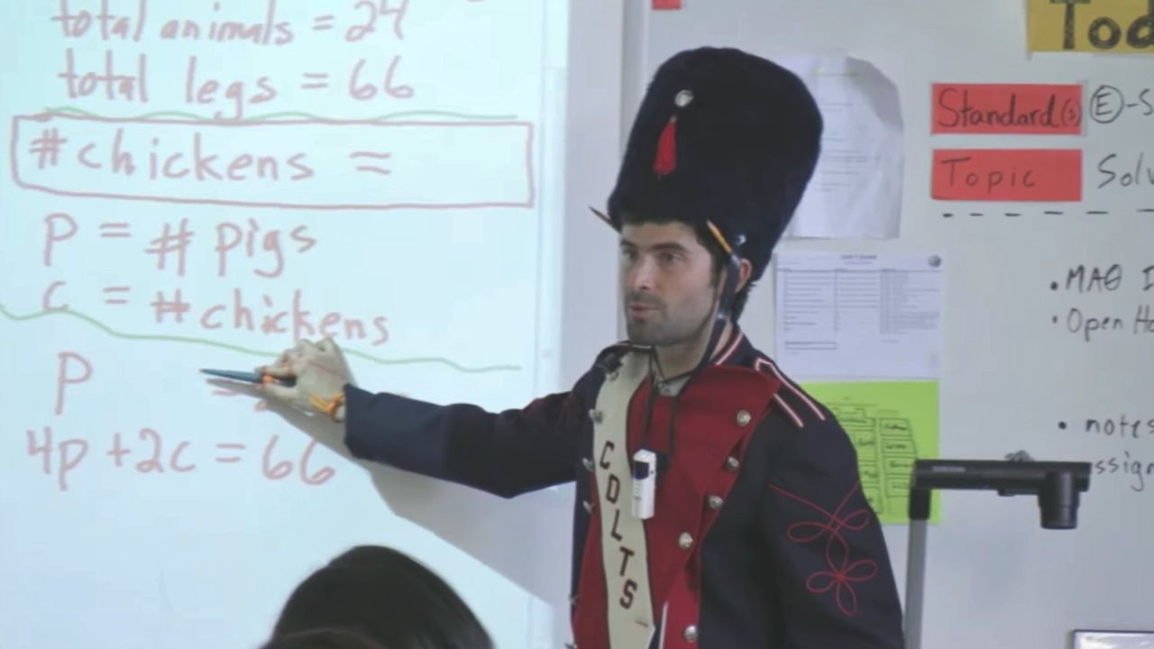 Teacher is in a solider costume teaching in front of a classroom