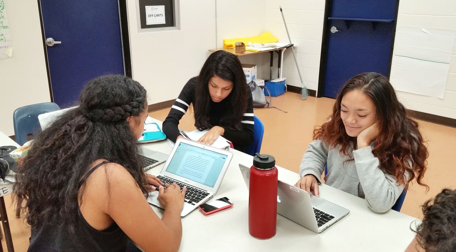 Students in the Teaching and Learning Academy Program at Wai'anae High School collaborate on coursework. Only half of the state's public school teachers typically remain teaching after five years.