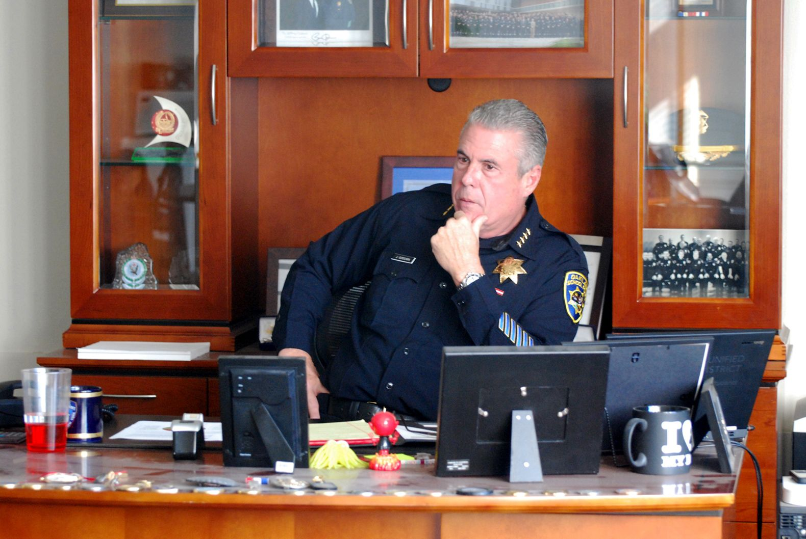 Chief Jeff Godown sits at his desk at the police station. Godown has been in law enforcement for 36 years.