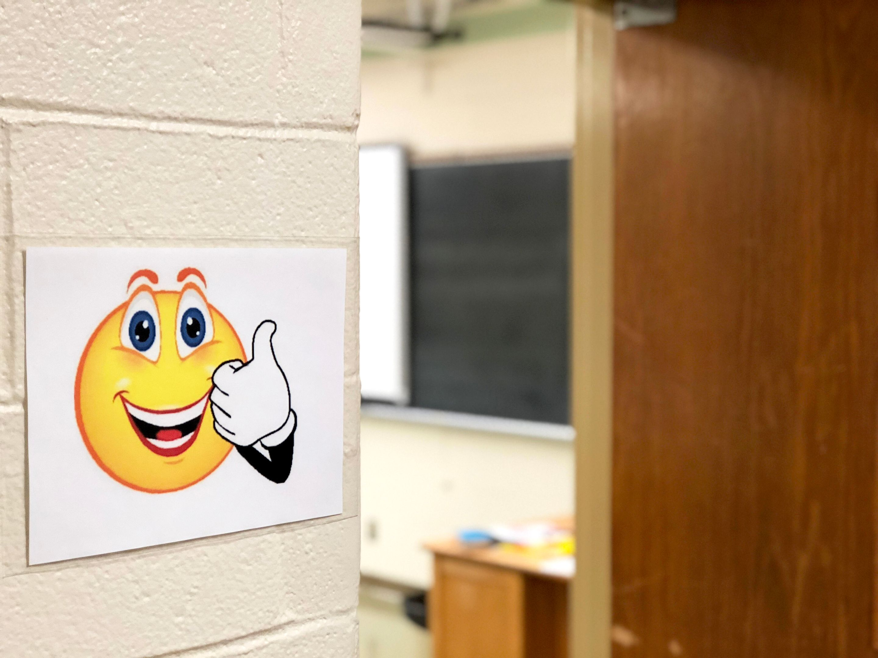 A sign with a smiley face and a thumbs up indicates an open classroom at North Valley Regional in New Jersey.