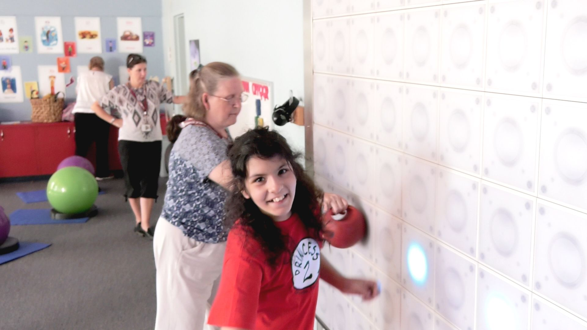 photo of a student using a light wall