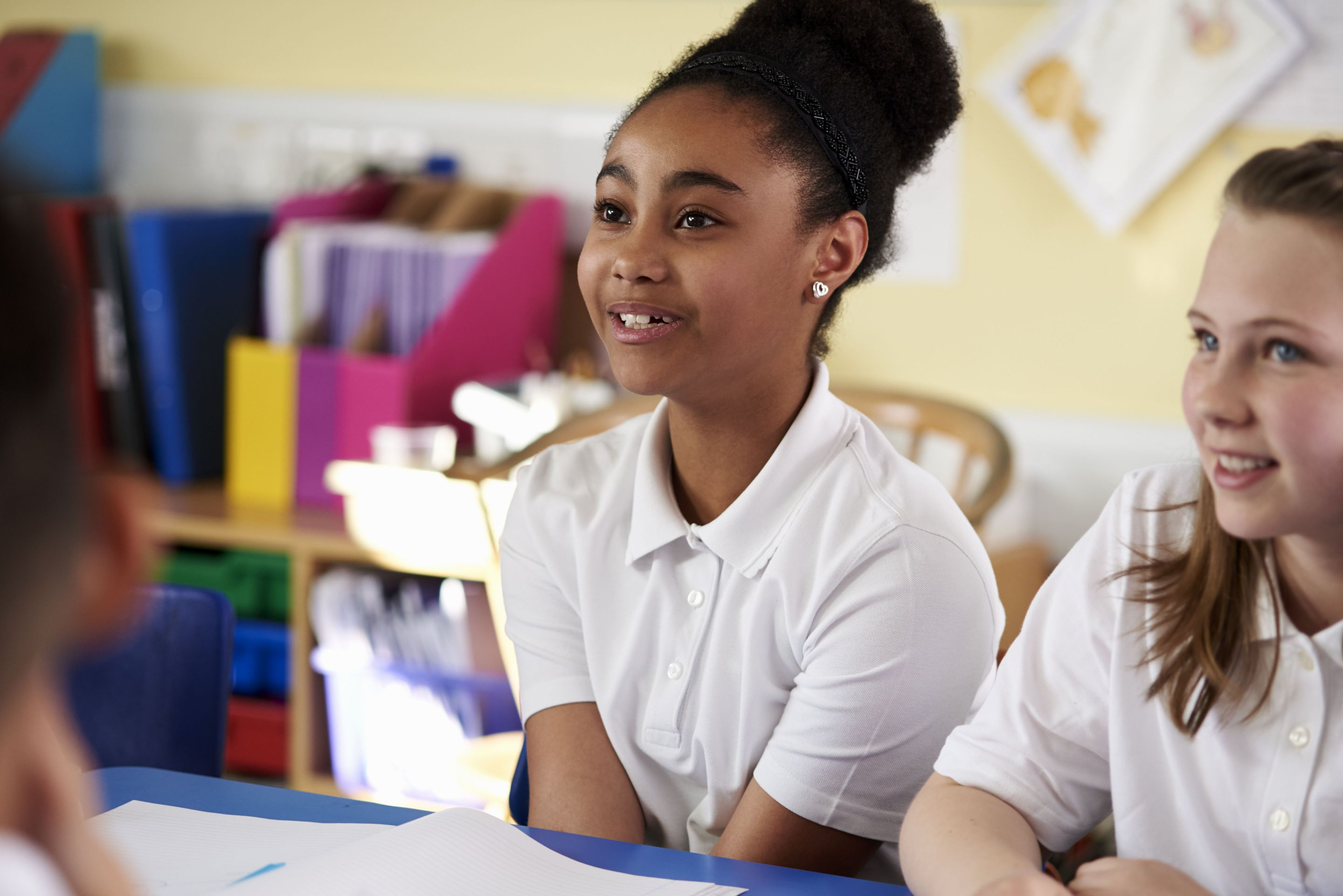 Young girl preparing to speak in class