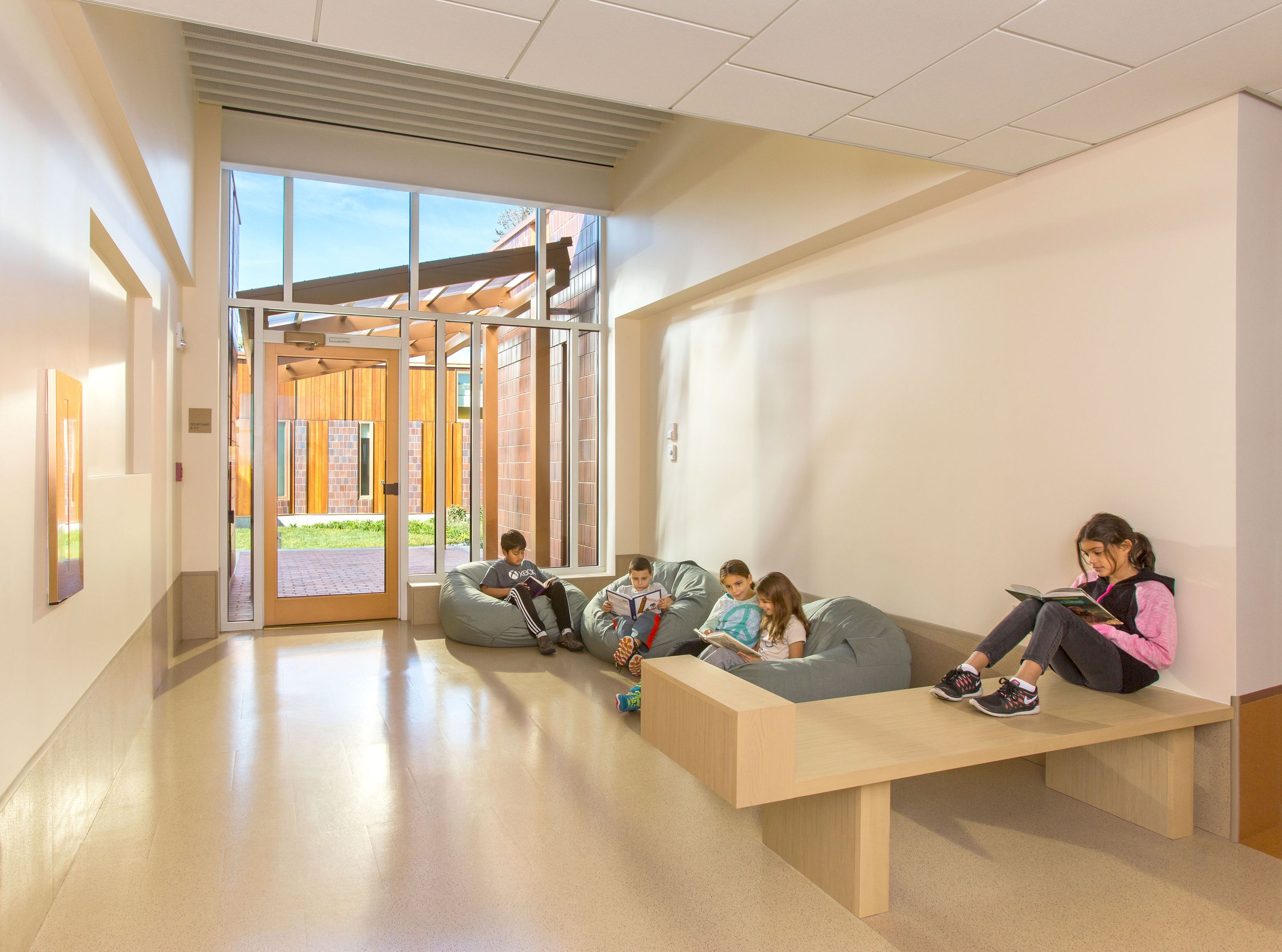 At Field Elementary School, a public school in Weston, Massachusetts, an alcove is used as a breakout space for small group collaboration.