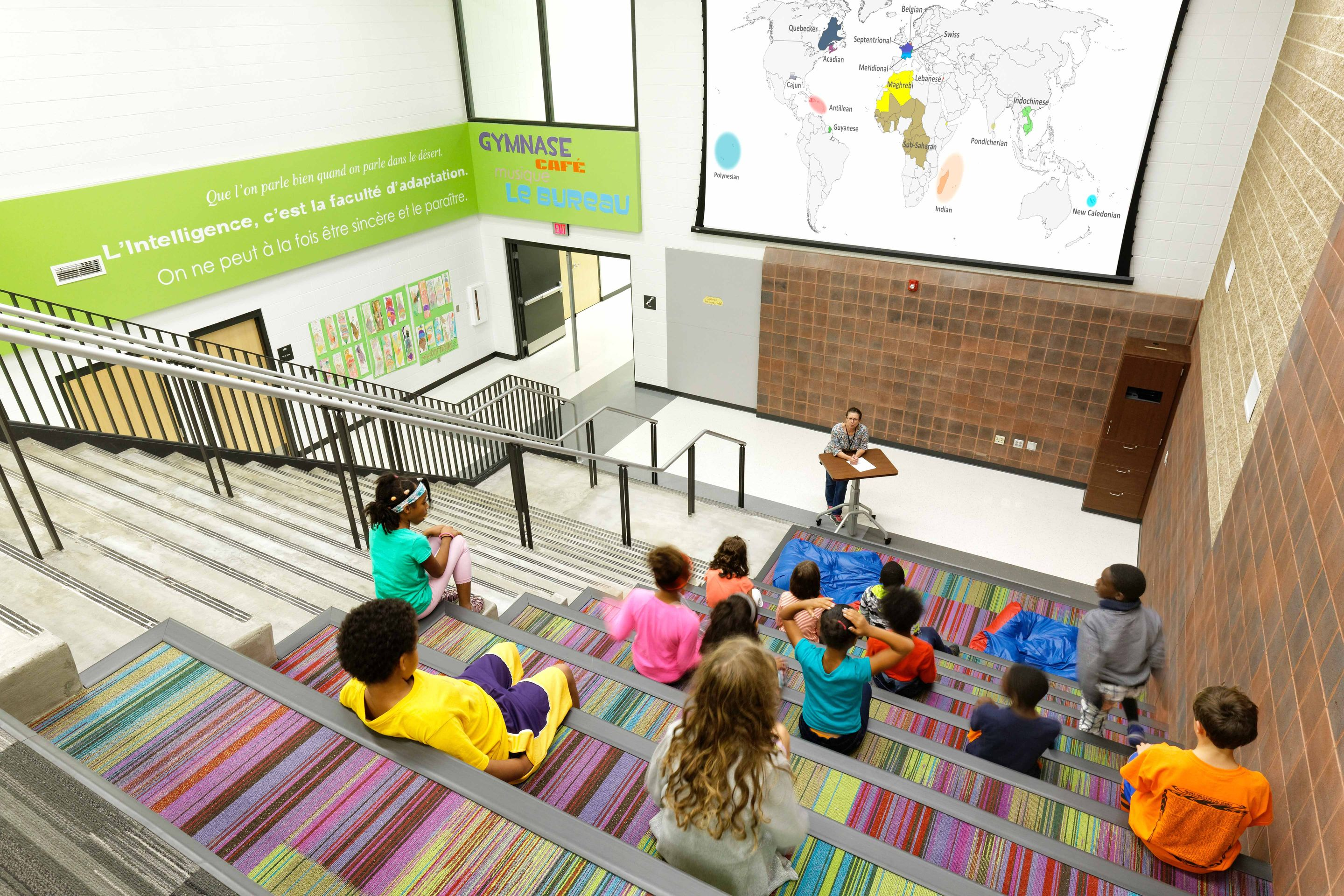 At Ecole Kenwood French Immersion School, the stairwell has transformed into a multipurpose space for lectures, presentations, collaboration, and socialization.