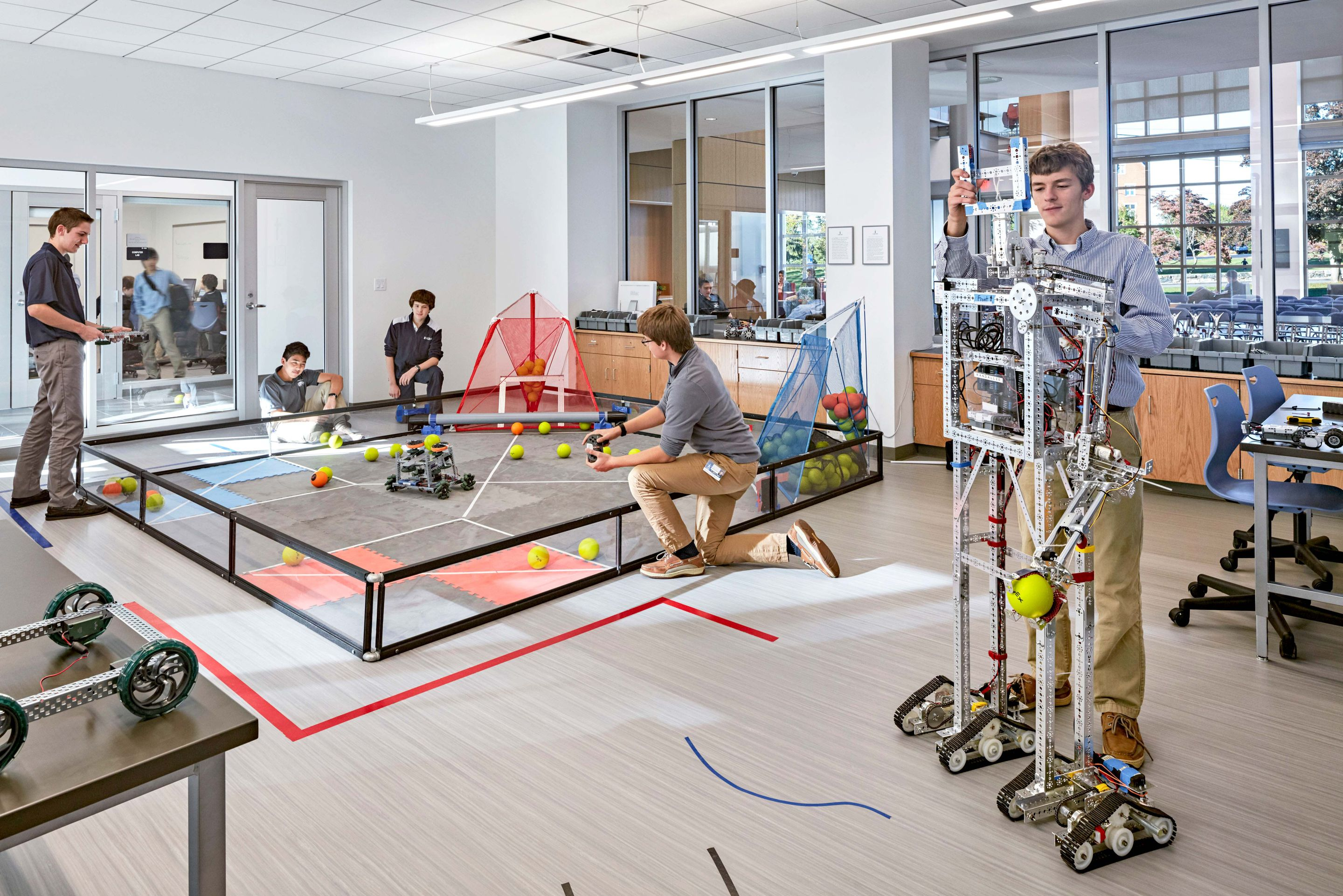 Although it's standard to integrate Wi-Fi and tech throughout a school, there's still a need for rooms with high-tech tools like 3D printers. St. John's Prep, a private school, has a robotics lab as part of its STEM commons.