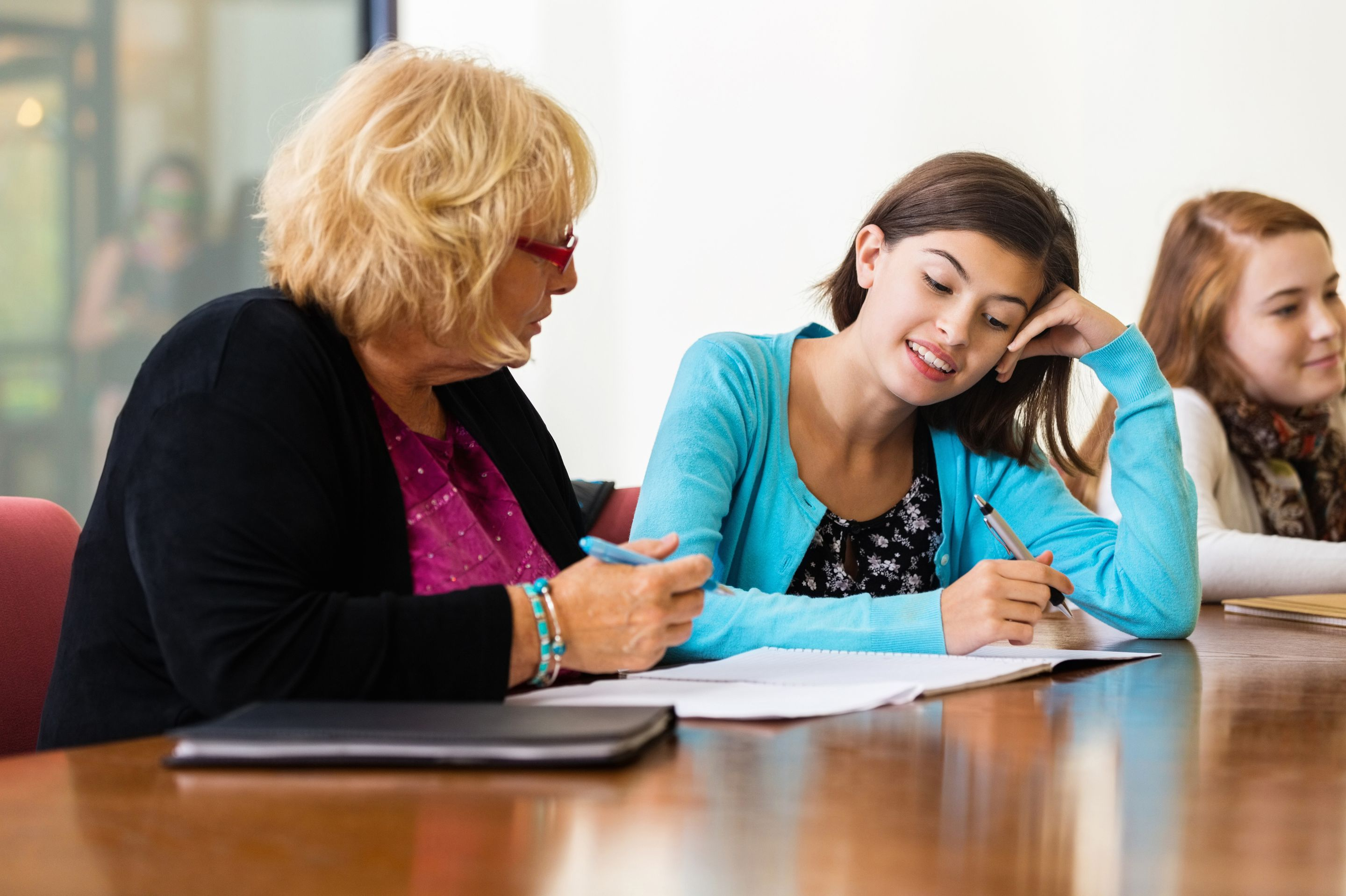 Teacher talking one-on-one with a student