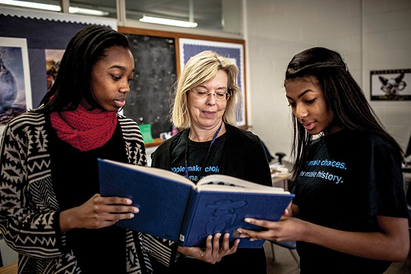 Two high school students at Overton High School work with Dr. Marilyn Taylor to discover the story of lynching in local Shelby County.