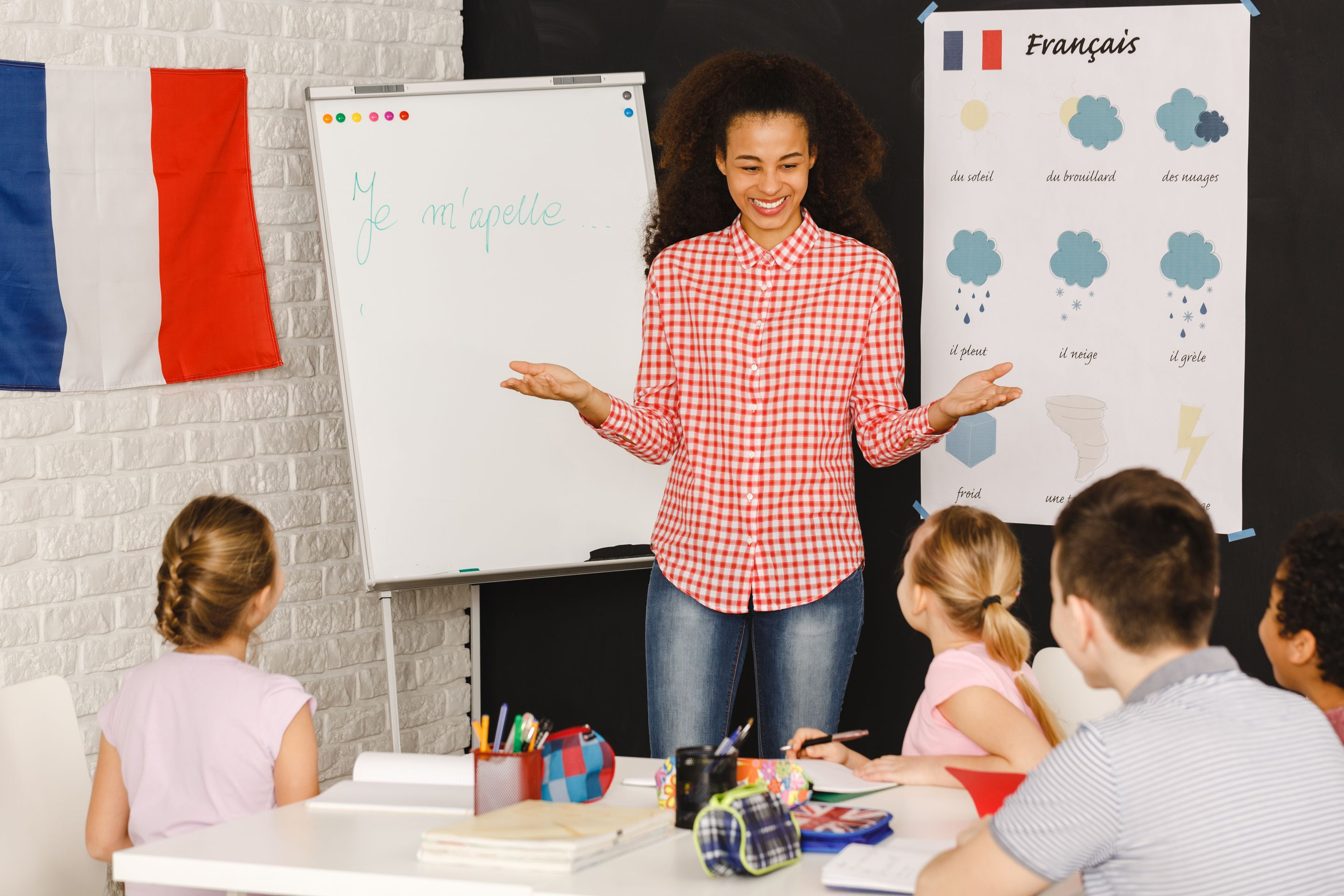 A French teacher instructing a class of middle school students