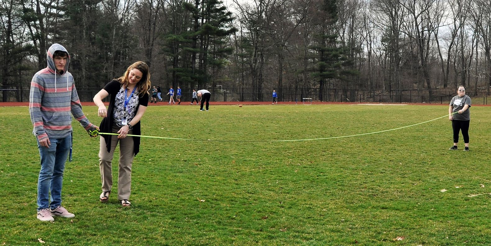 "Ashley Swords and her students measure the football field as part of their investigation of the Holocaust through Elie Wiesel's novel ""Night."""