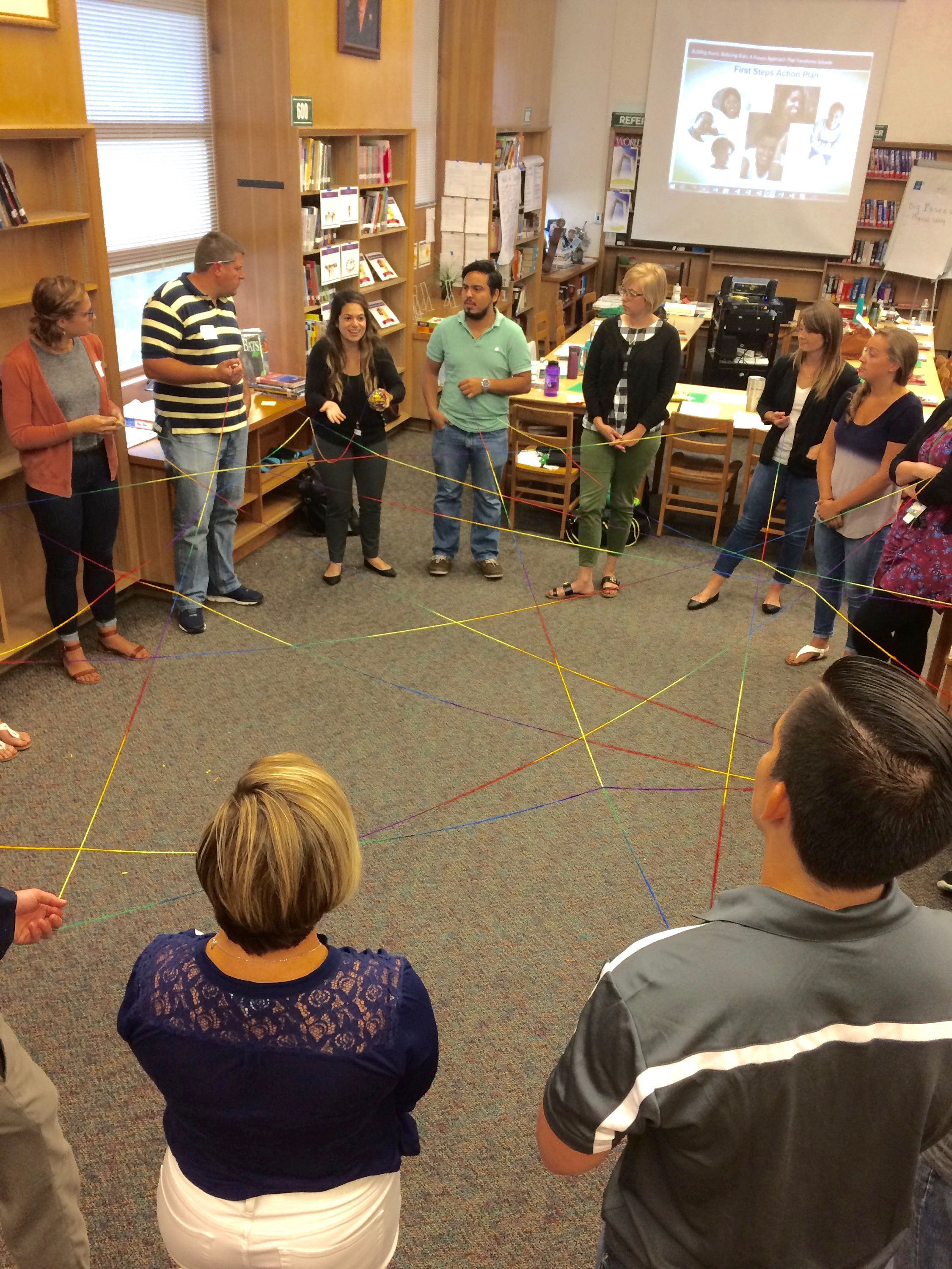 Teachers at Bryan Adams High School Leadership Academy participate in a summer BARR training.