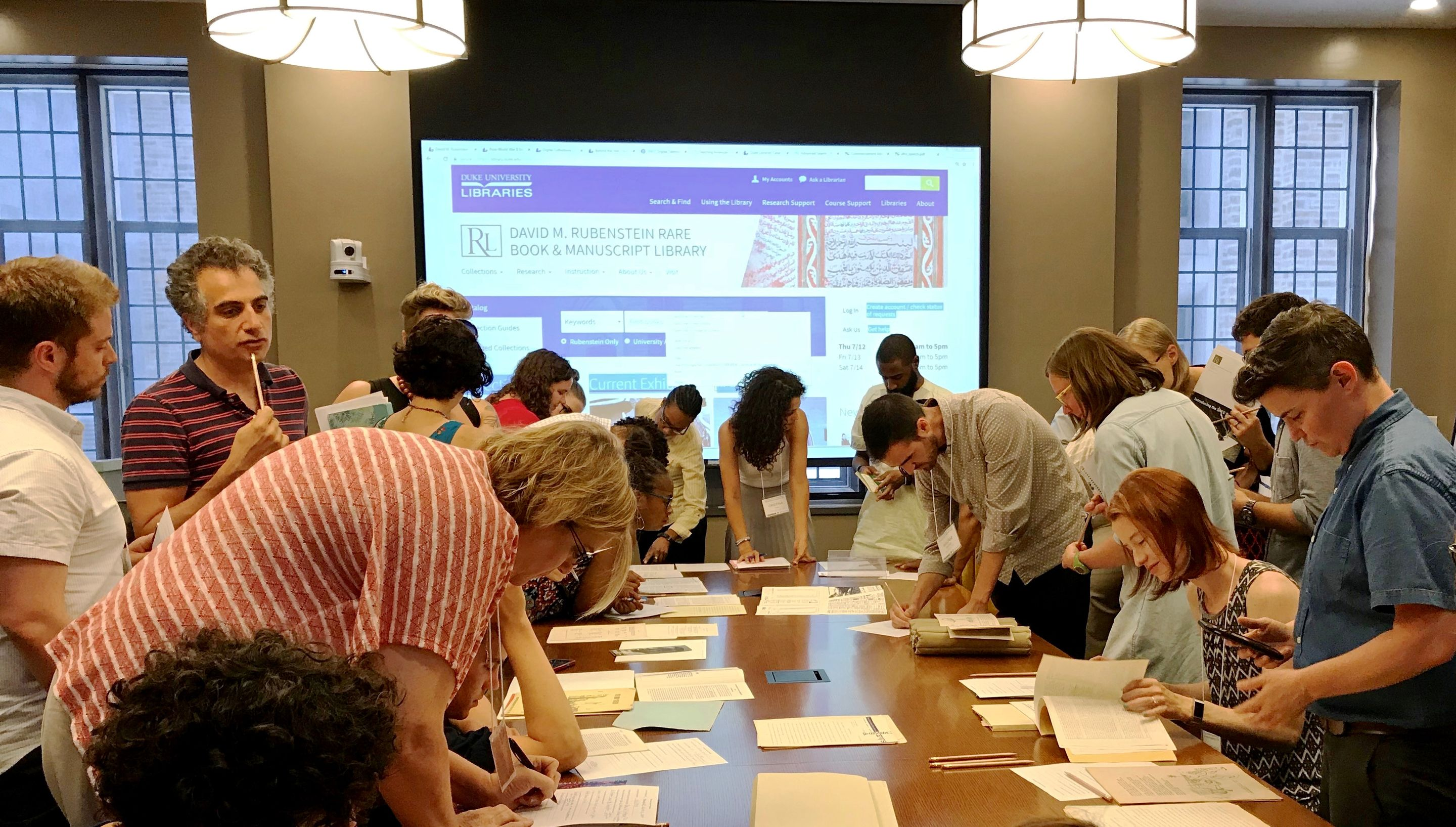Teachers at the summer institute explore primary documents at Duke University's David M. Rubenstein Rare Book and Manuscript Library.