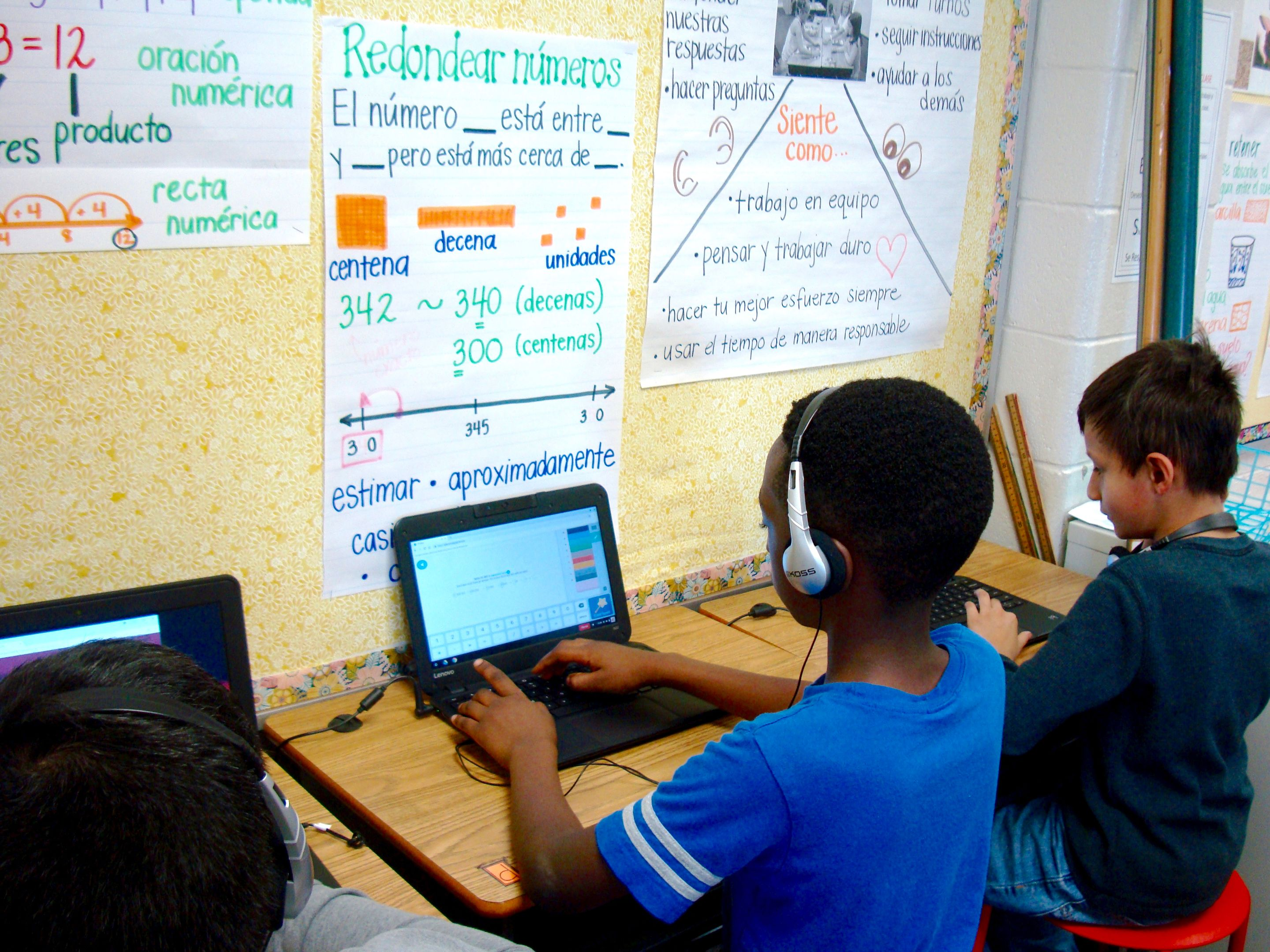 Students in the dual immersion program at Bethesda Elementary School work on a computer activity.