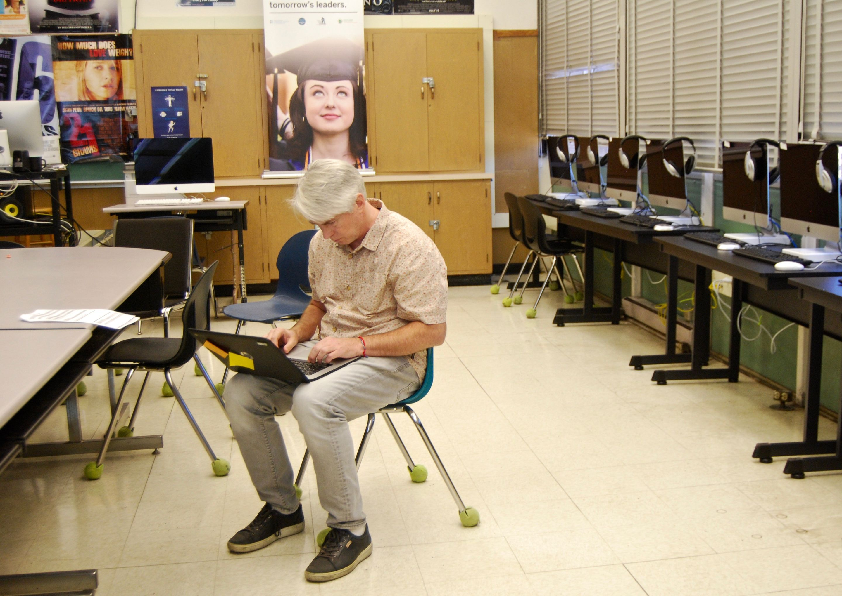 A Skyline teacher in the Computer Science Pathway examines a list of students needing extra support.