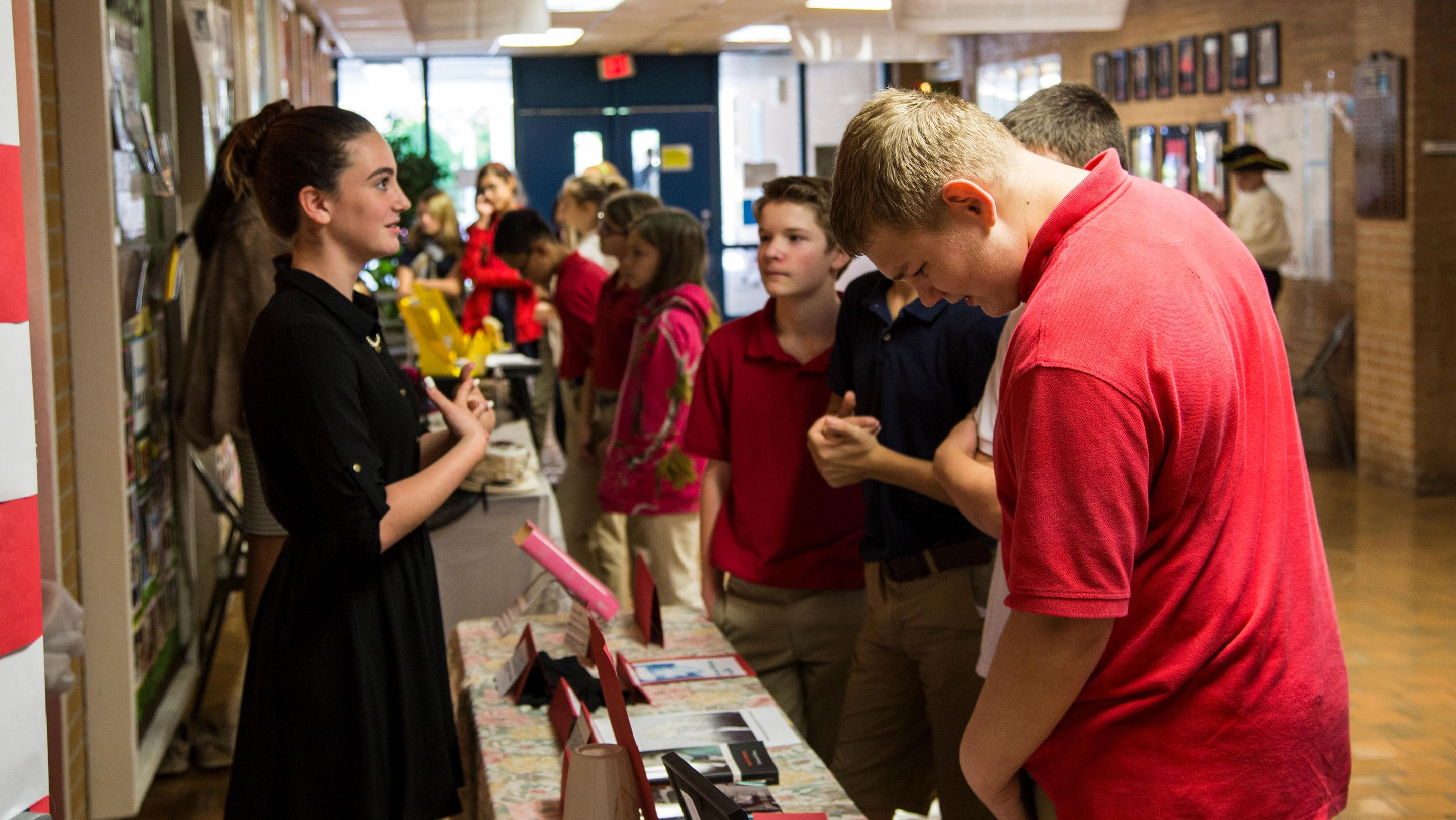 "High school students reenacting various historical figures in a ""wax museum"" project"