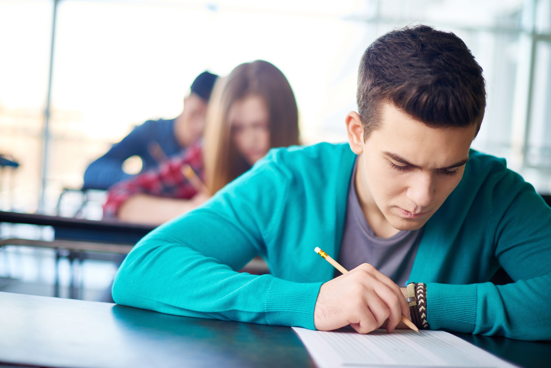 Three high school students retaking a test