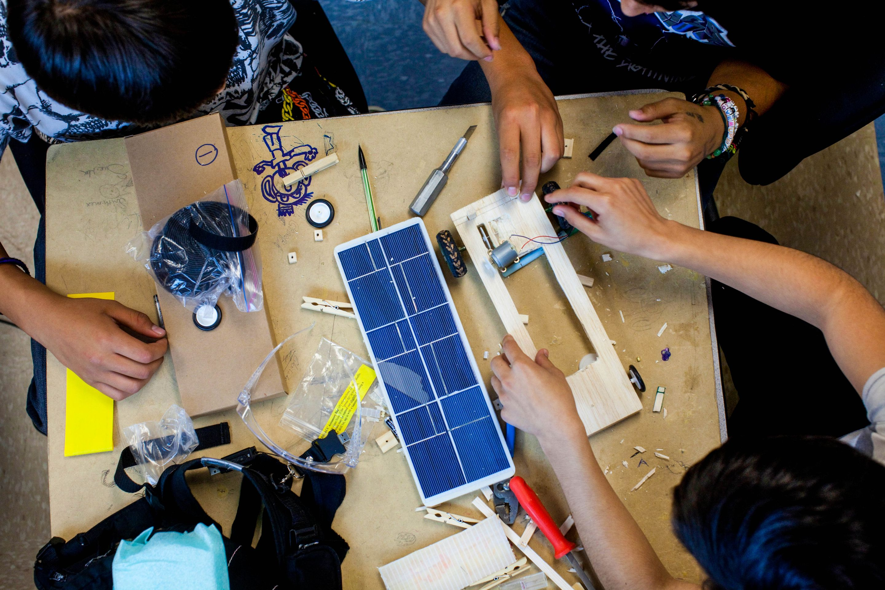 High school students working on a solar car project