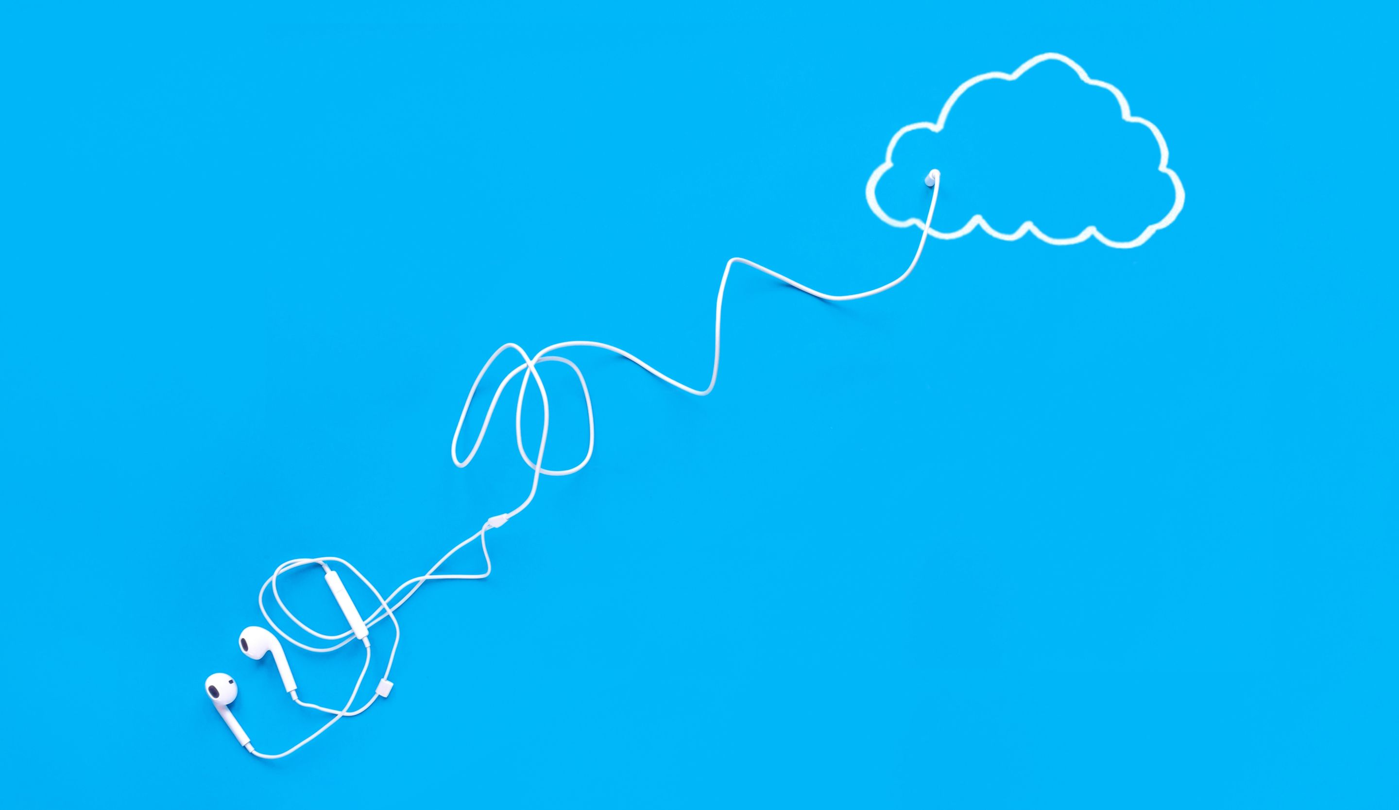 Photo illustration of earbuds plugged into cloud