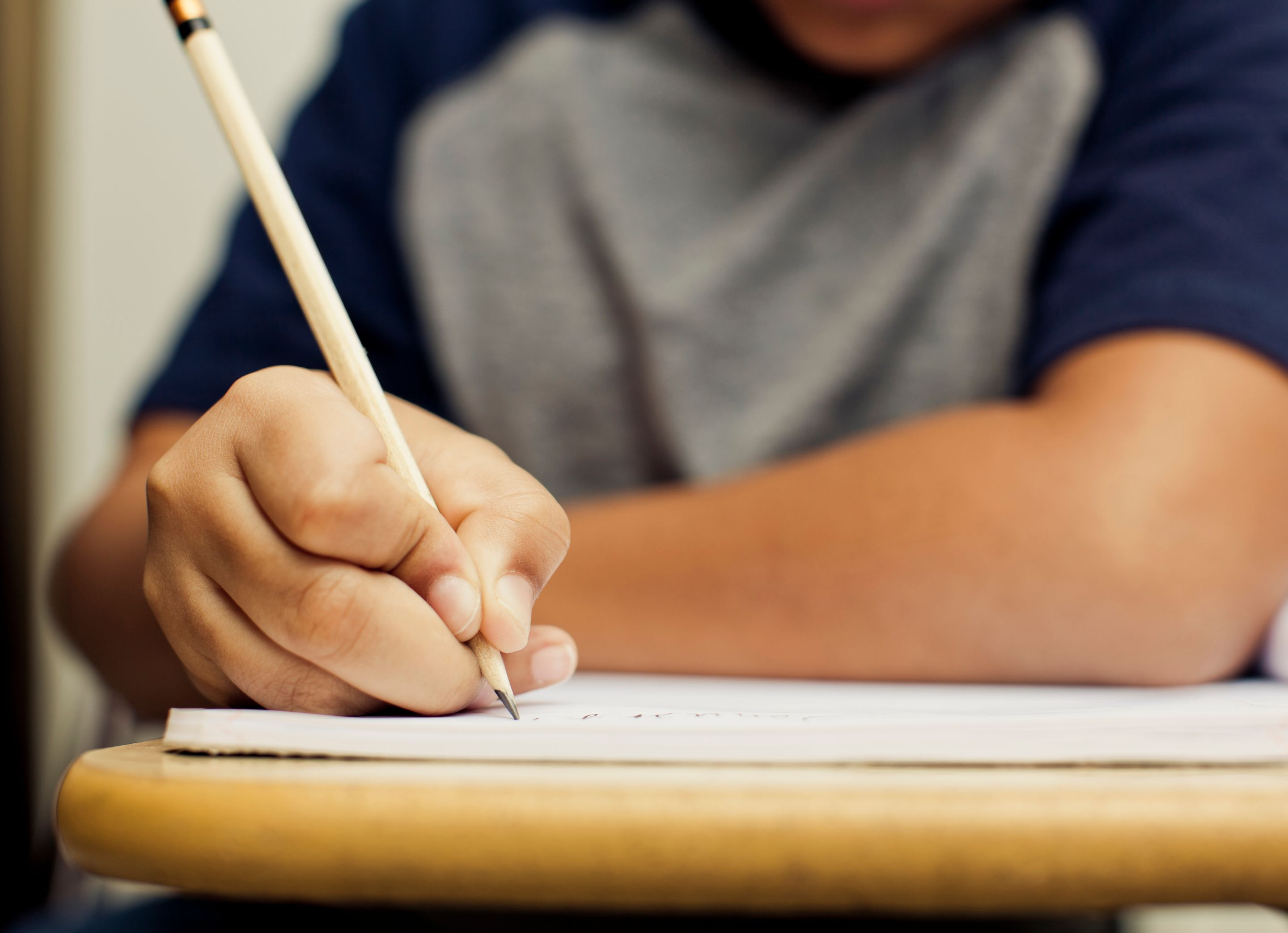 Male student writing a letter