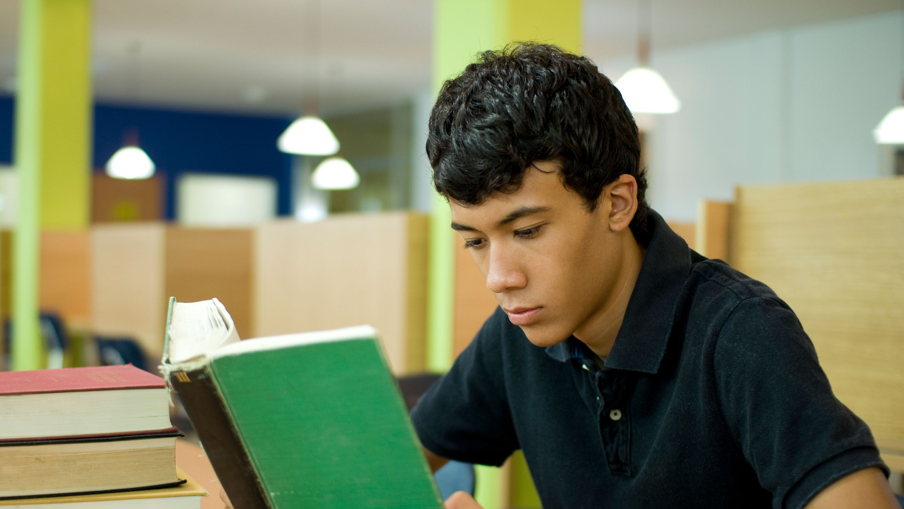 photo of a student reading a book