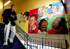 Not Alone: A student takes the stairs by one of the many murals that adorn the Boston Arts Academy.