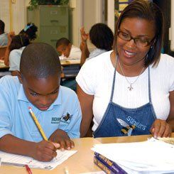 More recently, Lewis-Carter at work helping a fourth-grade student.