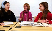 Warm Relations: Alicia Stube (left) and Jessica Lewis discuss art history with Professor Joan DelPlato.