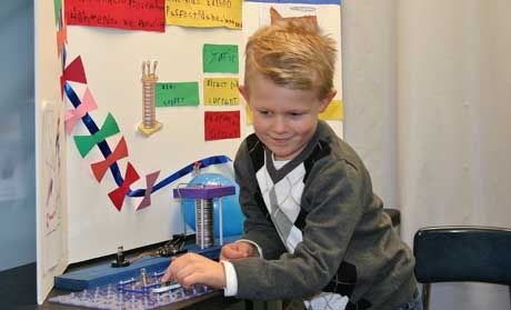 A New Morning student demonstrates electricity for his Museum project