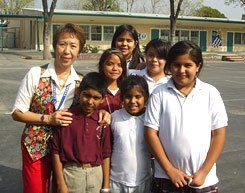 Principal Yvonne Chan with students at the Vaughn Next Century Learning Center.