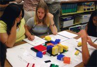Legos for the Real World:  Teams use color-coded Legos to illustrate their development proposals. These urban planners are economics students from Washington & Lee High School, in Alexandria, Virginia.