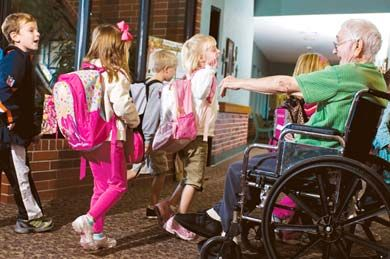 "Ageless Friendship: ""Grandpa"" Paul Bookout welcomes kindergartners to school at Grace Living Center."
