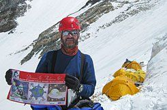 Educational Standard:  Climber Chip Popoviciu holds a student-designed flag 24,500 feet up Mount Everest. He sent photographs with the flag to students from different points along his journey.