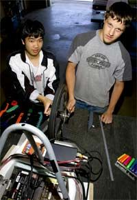 Pit Stop: Hiram Johnson High School student Julian Xin C (above left) and Nick Buell fine-tune the alignment on a three-wheel solarpowered racer.