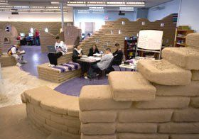 Open Education:  Students at Robert F. Kennedy Charter High School, in Albuquerque, New Mexico, designed study areas that reflect the belief that true learning cannot be compartmentalized by subject.
