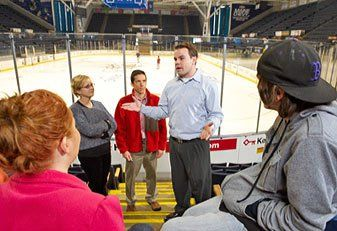 Pirate Loot: Casco Bay High School students listen intently as they get a lesson on business from Portland Pirates executive Ryan Delaney.