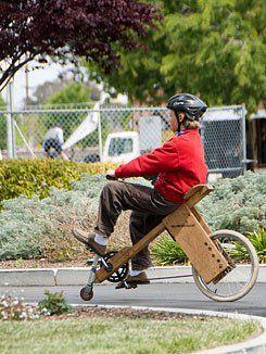 Wood Turning:  A student tests a custom-built bike.