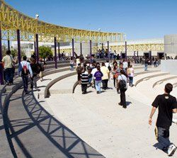 Sky's the Limit: Students walking to class through the amphitheater-like open courtyard.