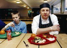 Laddies Who Lunch:  English chef Jamie Oliver, with one of his own creations -- and a satisfied customer -- has cooked up his own design for a perfect learning environment.