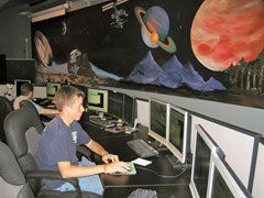 Spaceship Stars: A student in the school's Mission Control center monitors a mission for NASA.