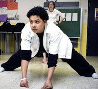No Dodgeball Here: Adam Gonzaga strikes a pose in aikido class as teacher Emily Walker observes.