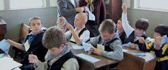 Stitch in Time: Immersion at Old Quasset means traditional garb, sewing along with math, and boys sitting on their own side of the classroom.