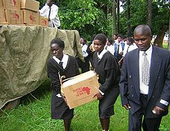 Weighty Subjects: Teenagers from Chifunabuli Basic School, in rural Zambia, haul books to their new library.