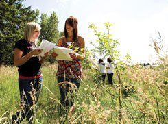 Field of Dreams: For Clackamas students Jessie Loter (left) and Alex Dolbey, classwork means going outside.