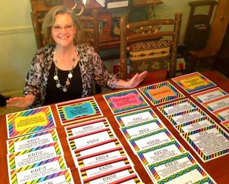 Cindy Dearman displays posters she found for her classroom using Pinterest.