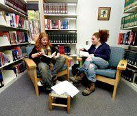 Bookworms: Saiya Miller (left) and Alexandra Barrett enjoy a quiet corner of the library.