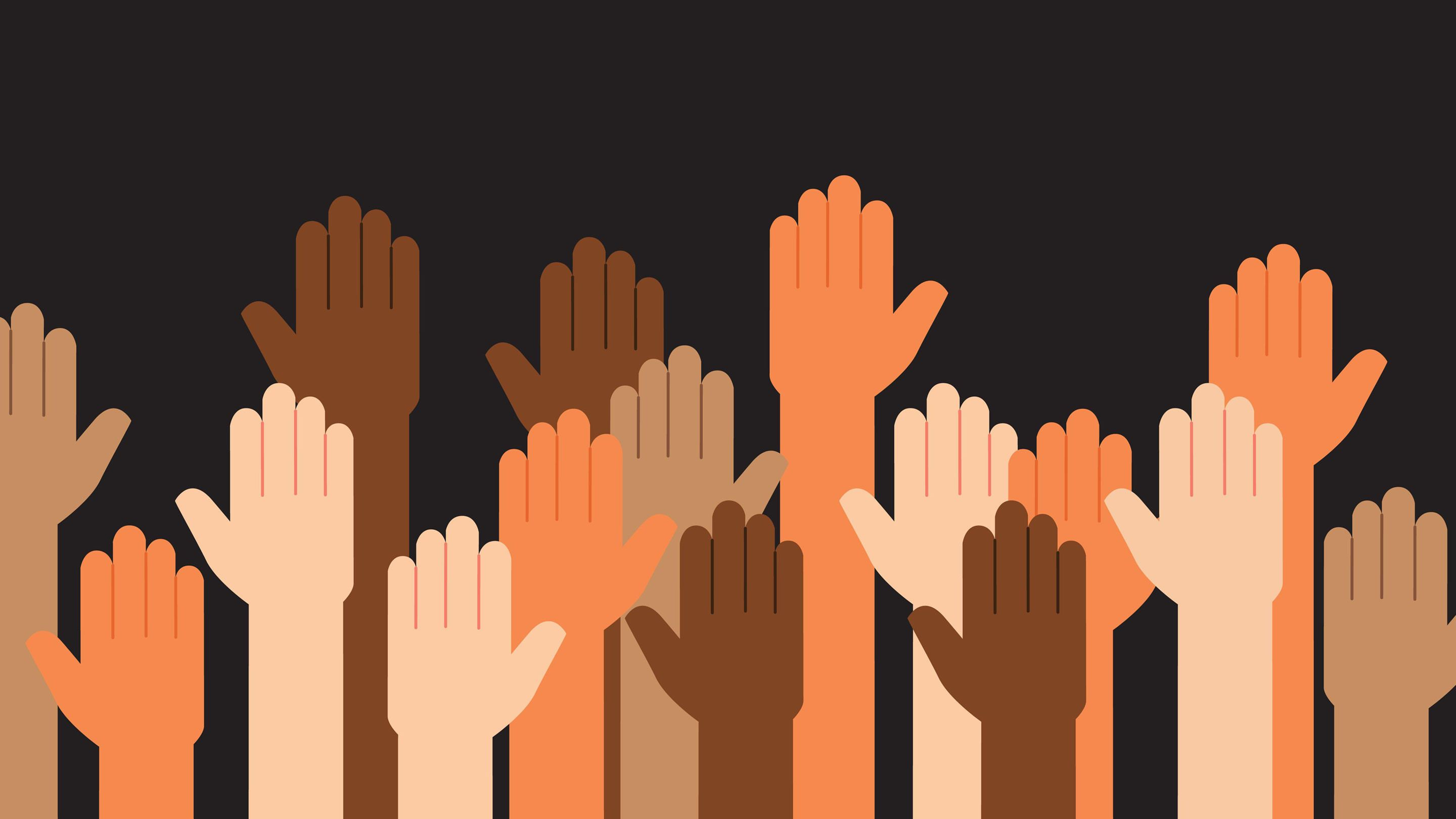 Hands of all colors raised in unison
