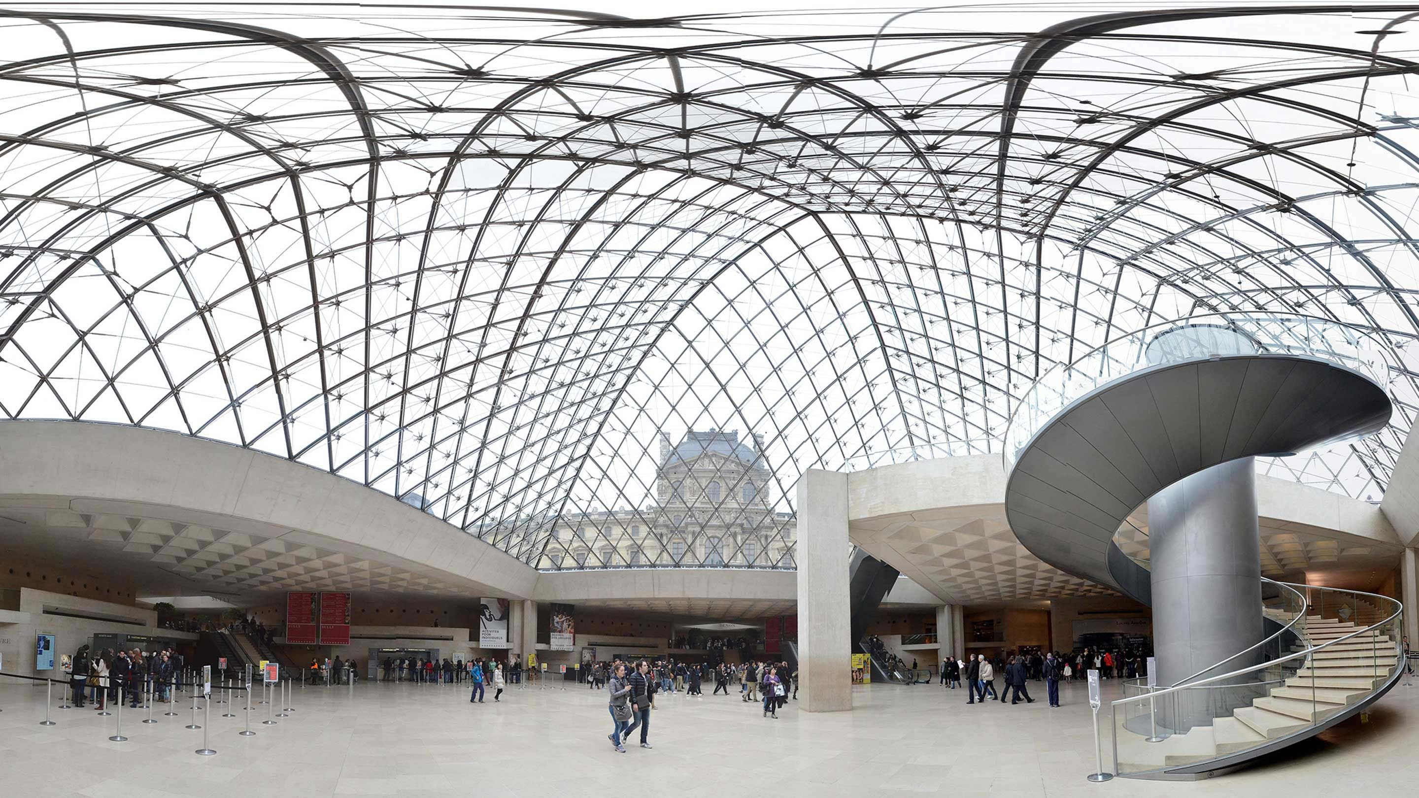 Panoramic view from under the glass pyramid at the Louvre in Paris.