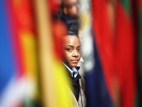 Girl looking through flags
