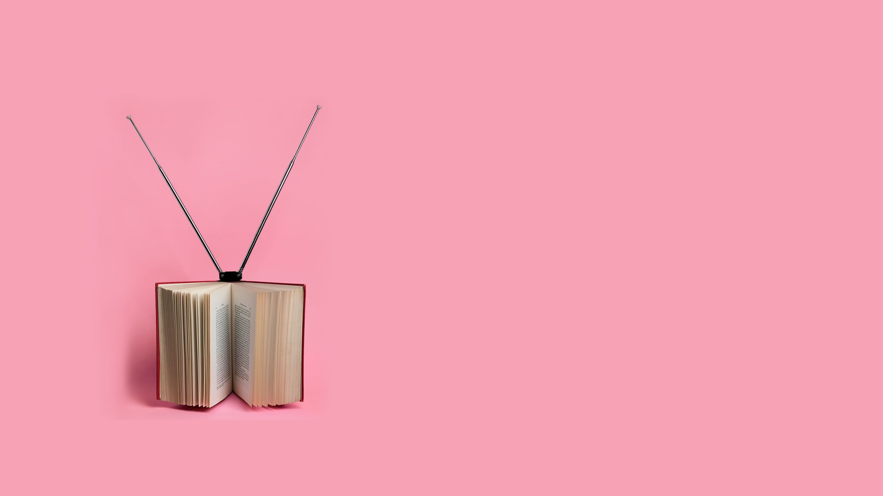 open book with TV antenna on the top
