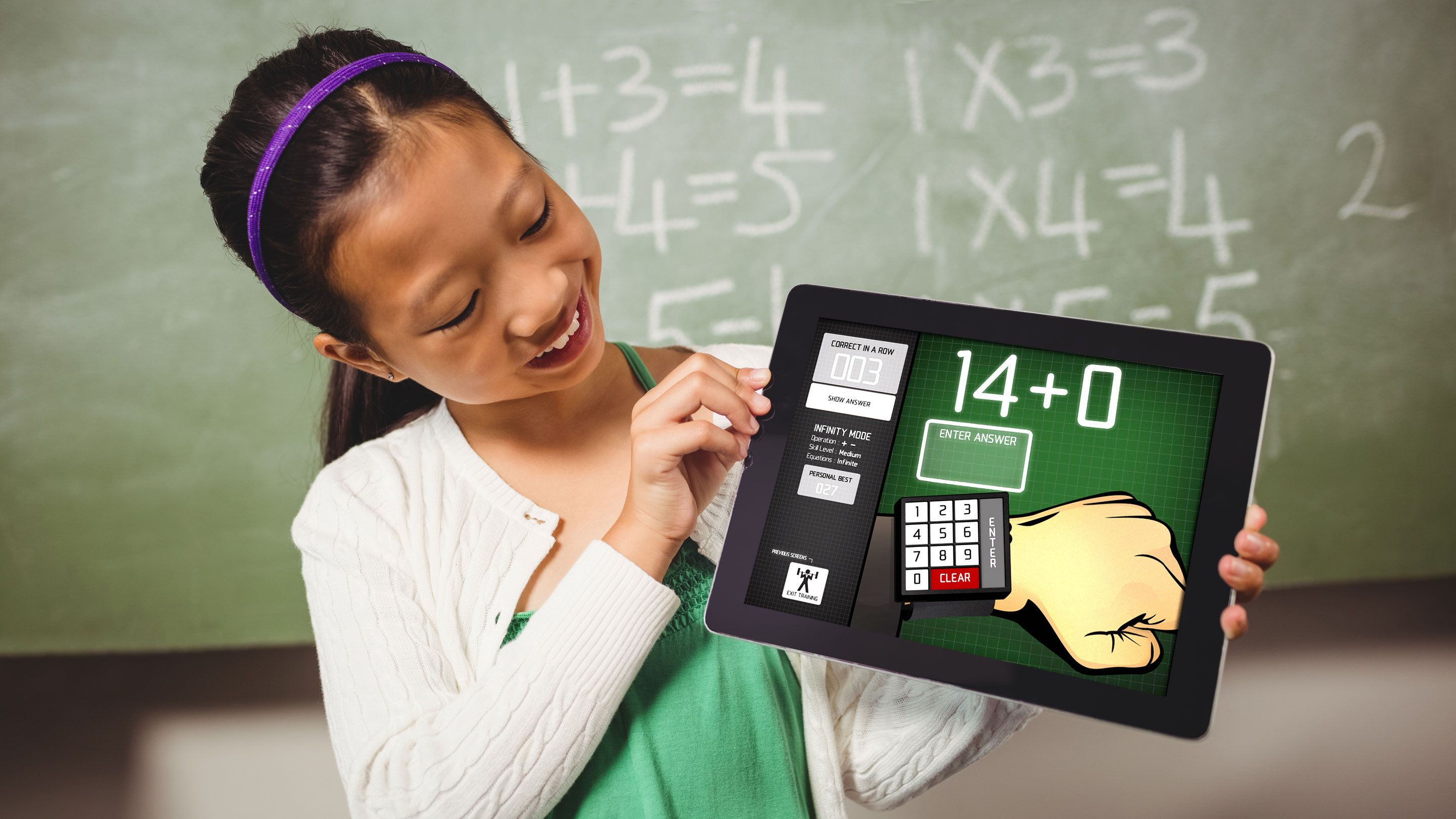 A girl looks at a math app on a tablet screen.