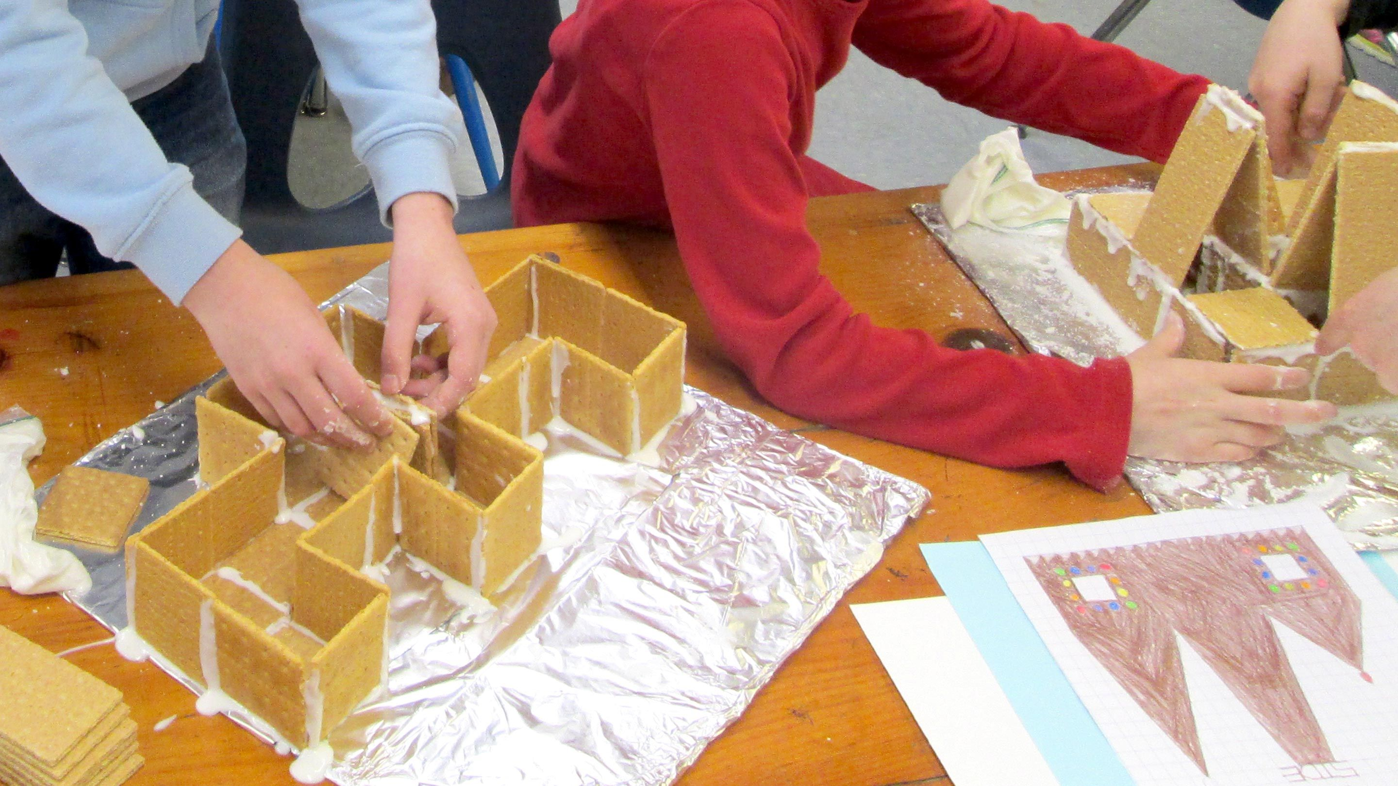 Kids build houses out of graham crackers in the author's class.